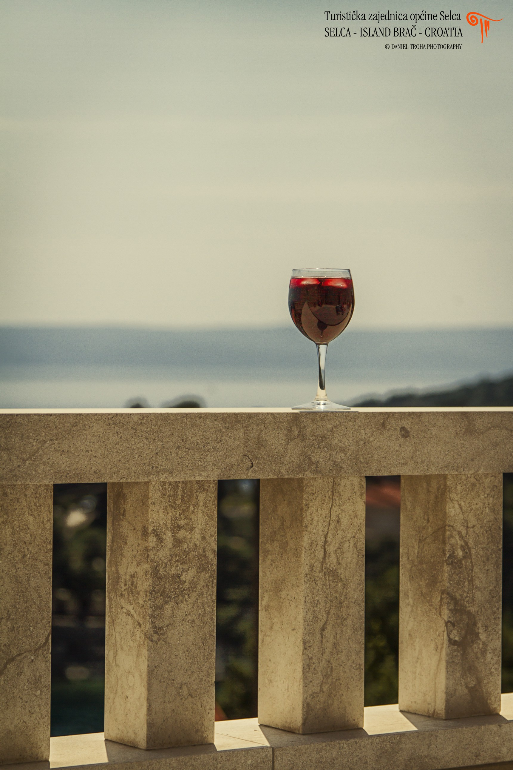 Glass of wine at the viewpoint of Selca