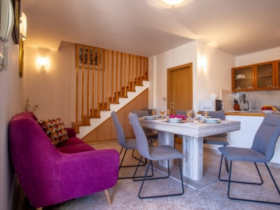 Modern furnished dining and living room with open kitchen in the Villa Bonaca